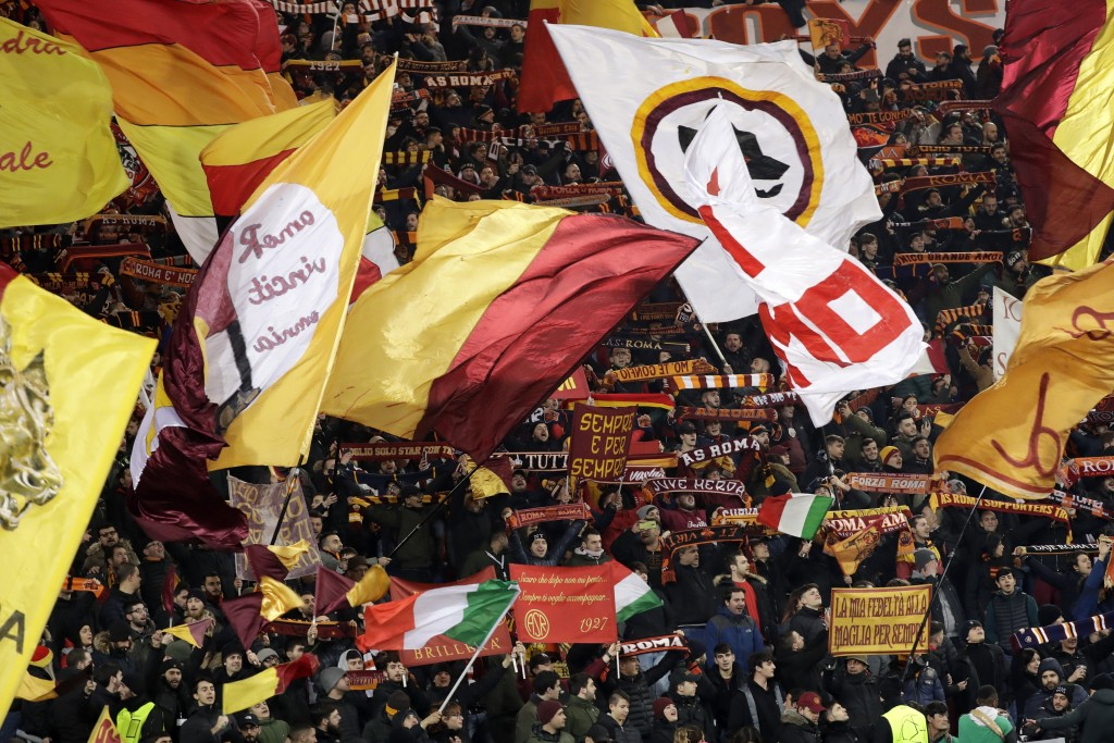 Roma fans cheer for their team before a Champions League round of 16 first leg soccer match between Roma and Porto, at Rome's Olympic Stadium, Tuesday