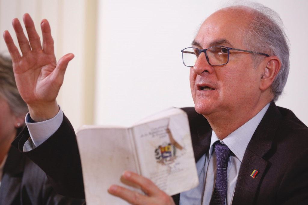 Antonio Ledezma, former mayor of Caracas , reads article 233 of the Venezuelan constitution as he attends a press conference at the Foreign Press Club...