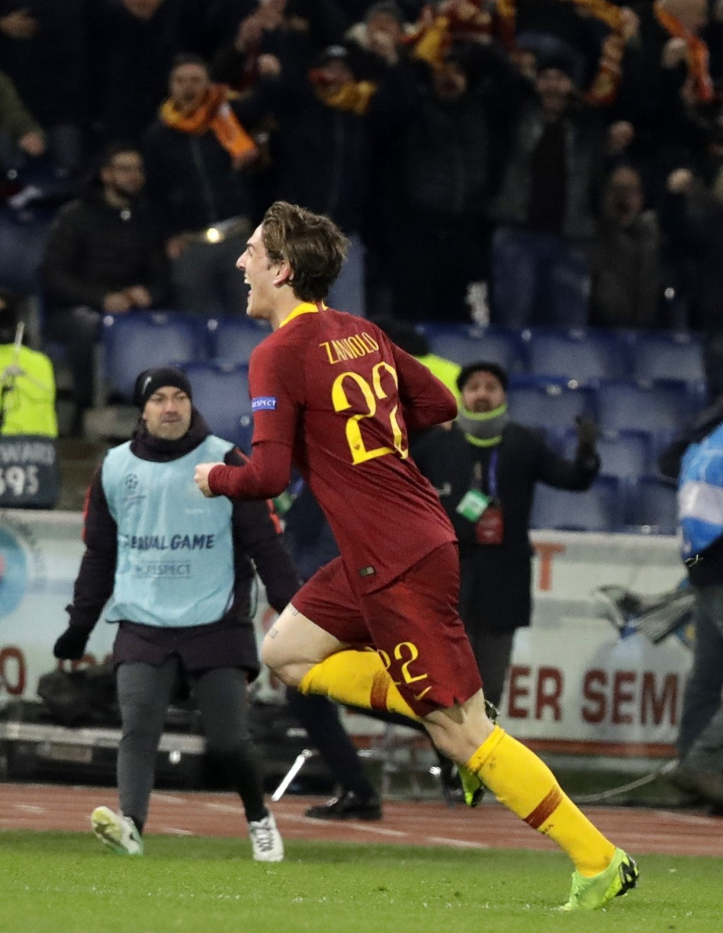 Roma midfielder Nicolo' Zaniolo celebrates after scoring the opening goal of his team during a Champions League round of 16 first leg soccer match bet...