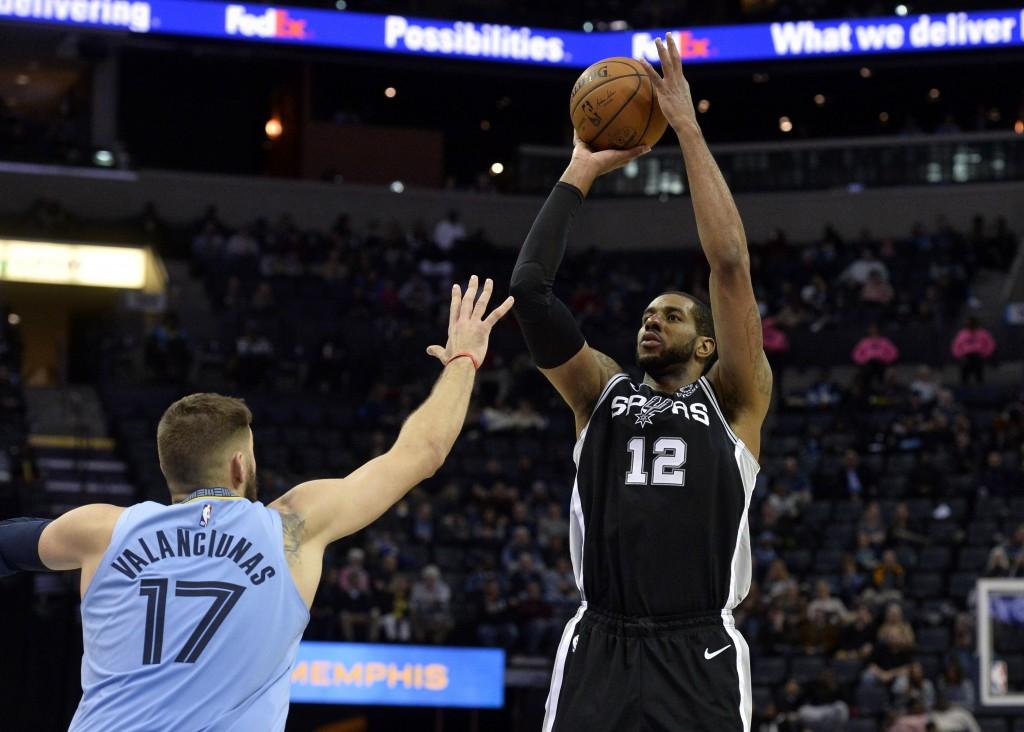 San Antonio Spurs center LaMarcus Aldridge (12) shoots over Memphis Grizzlies center Jonas Valanciunas (17) during the second half of an NBA basketbal...