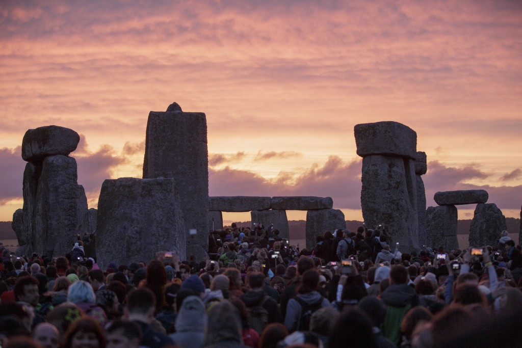 FILE - In this Sunday, June 21, 2015 file photo, the sun rises as thousands of revellers gather at the ancient stone circle Stonehenge to celebrate th
