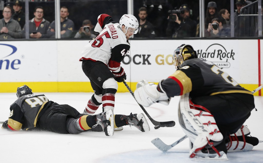 Arizona Coyotes right wing Josh Archibald (45) shoots and scores against Vegas Golden Knights goaltender Marc-Andre Fleury (29) during the third perio...