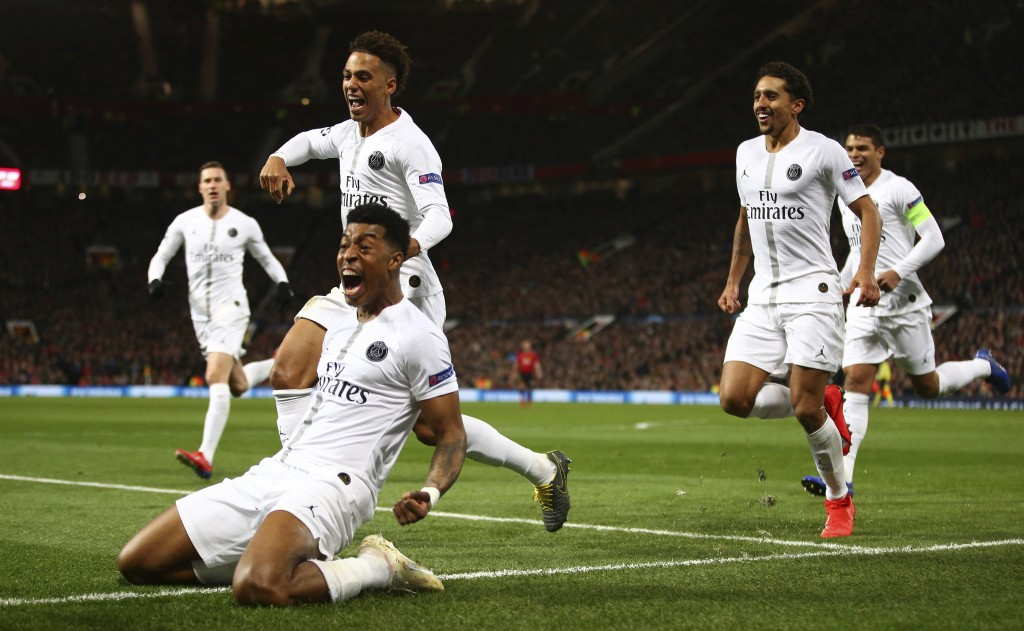 Paris Saint Germain's Presnel Kimpembe, left, celebrates after scoring the opening goal the game during the Champions League round of 16 soccer match