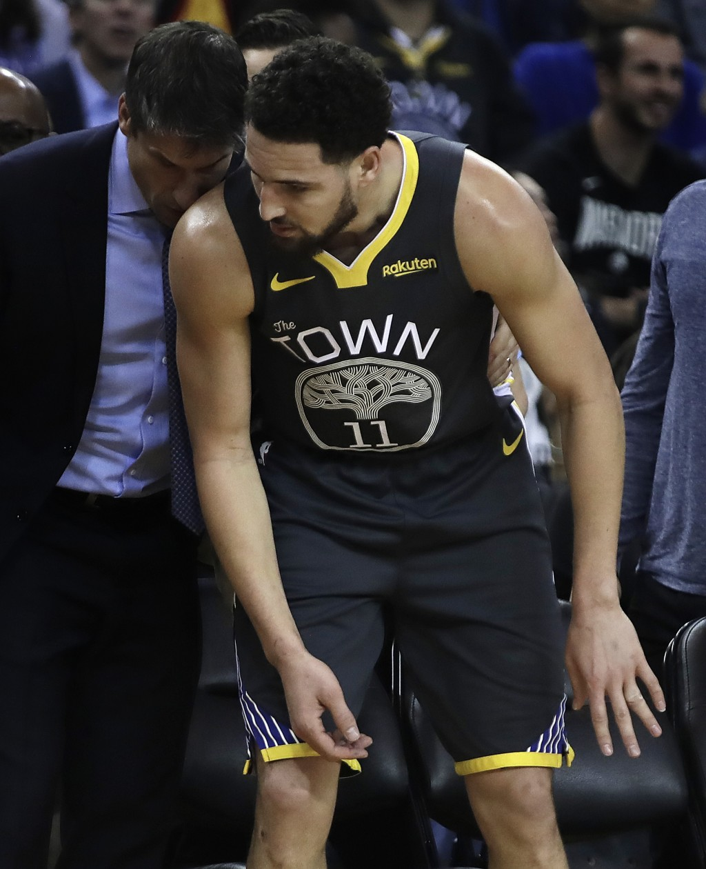 Golden State Warriors' Klay Thompson leaves in the first half of an NBA basketball game against the Utah Jazz with a sprained finger, Tuesday, Feb. 12