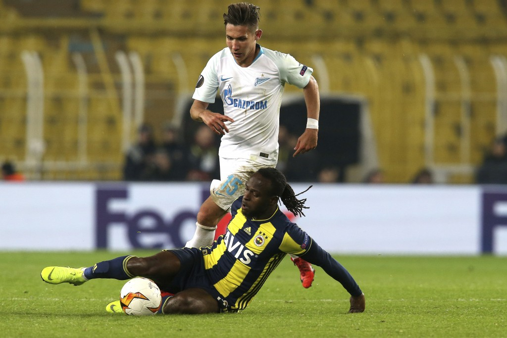 Fenerbahce's Victor Moses, on the ground, fights for the ball Zenit St. Petersburg's Elmir Nabiullin during the Europa League round of 32 soccer match...