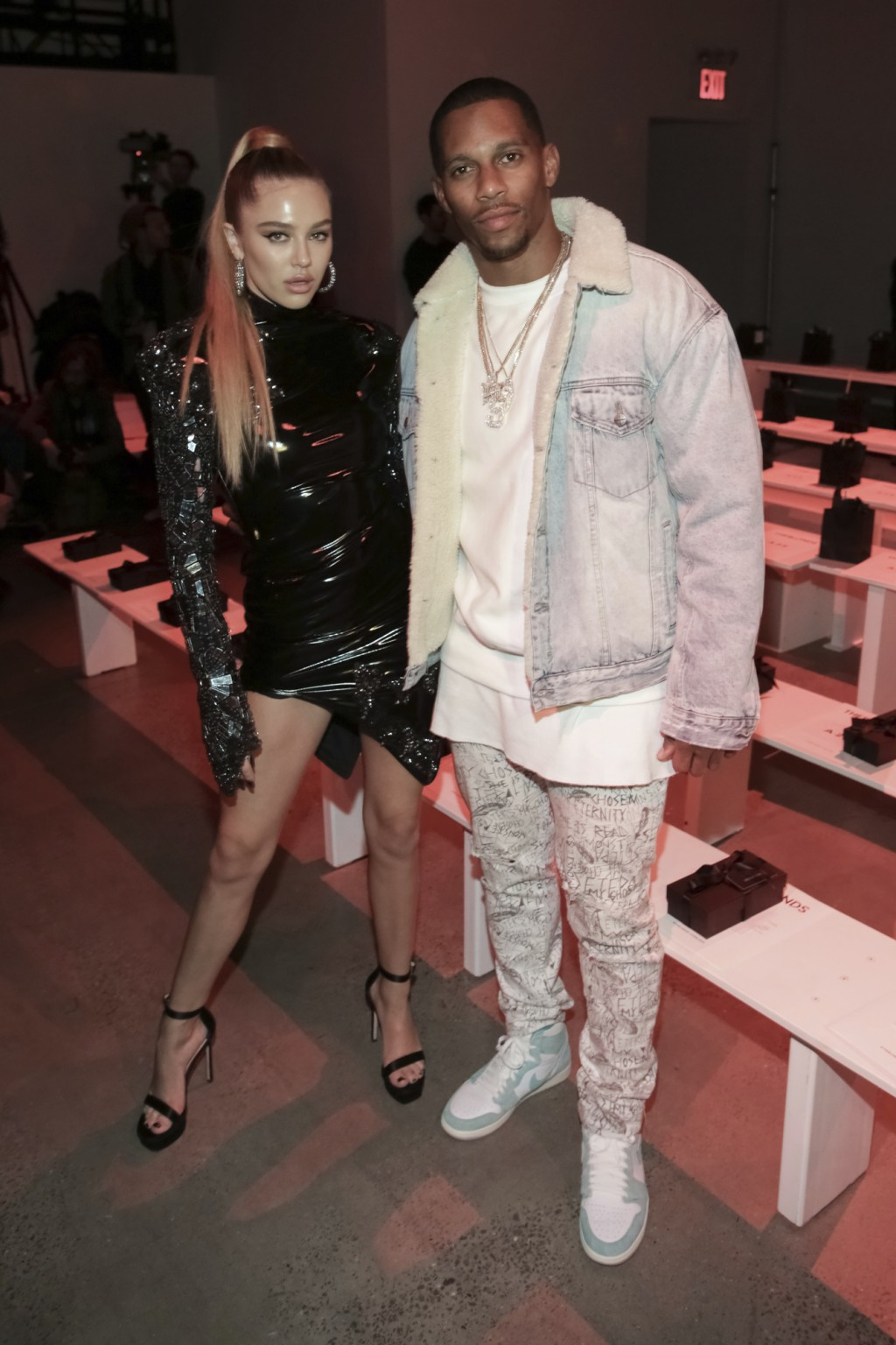 Delilah Belle Hamlin, left, and Victor Cruz attend The Blonds Runway Show held at Spring Studios during New York Fashion Week on Tuesday, Feb. 12, 201...