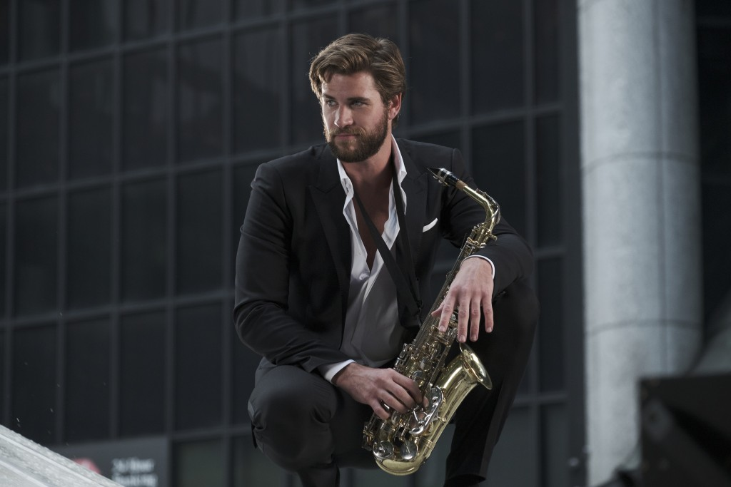 "This image released by Warner Bros. Pictures shows Liam Hemsworth in a scene from ""Isn't It Romantic."" (Michael Parmelee/Warner Bros. Pictures via AP)"