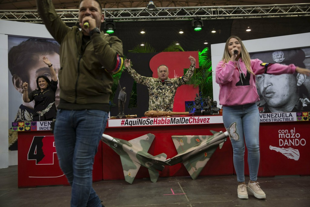 In this Feb. 6, 2019 photo, Diosdado Cabello, president of the ruling party-dominated constitutional assembly, center, dances as his daughter Daniella