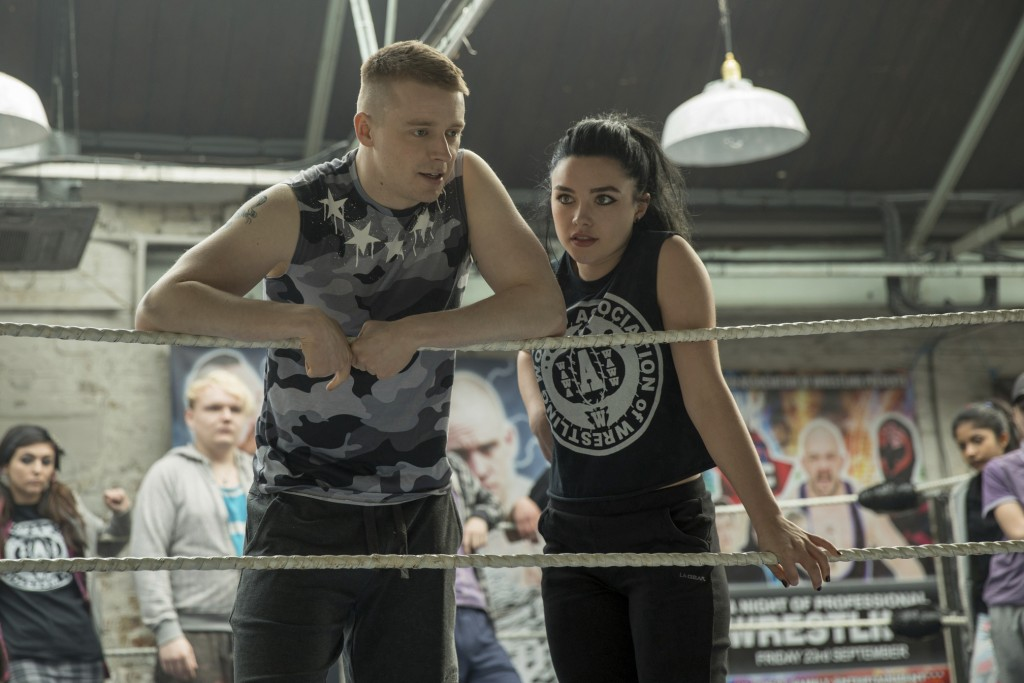 "This image released by Metro Goldwyn Mayer Pictures shows Jack Lowden, left, and Florence Pugh in a scene from ""Fighting with My Family."" (Robert Vigl..."