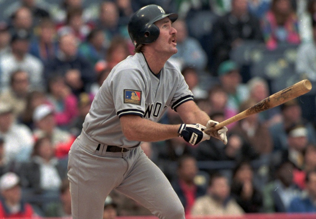 FILE - In this May 14, 1994, file photo, New York Yankees' wears Major League Baseball's 100th anniversary patch as he follows the flight of his ninth