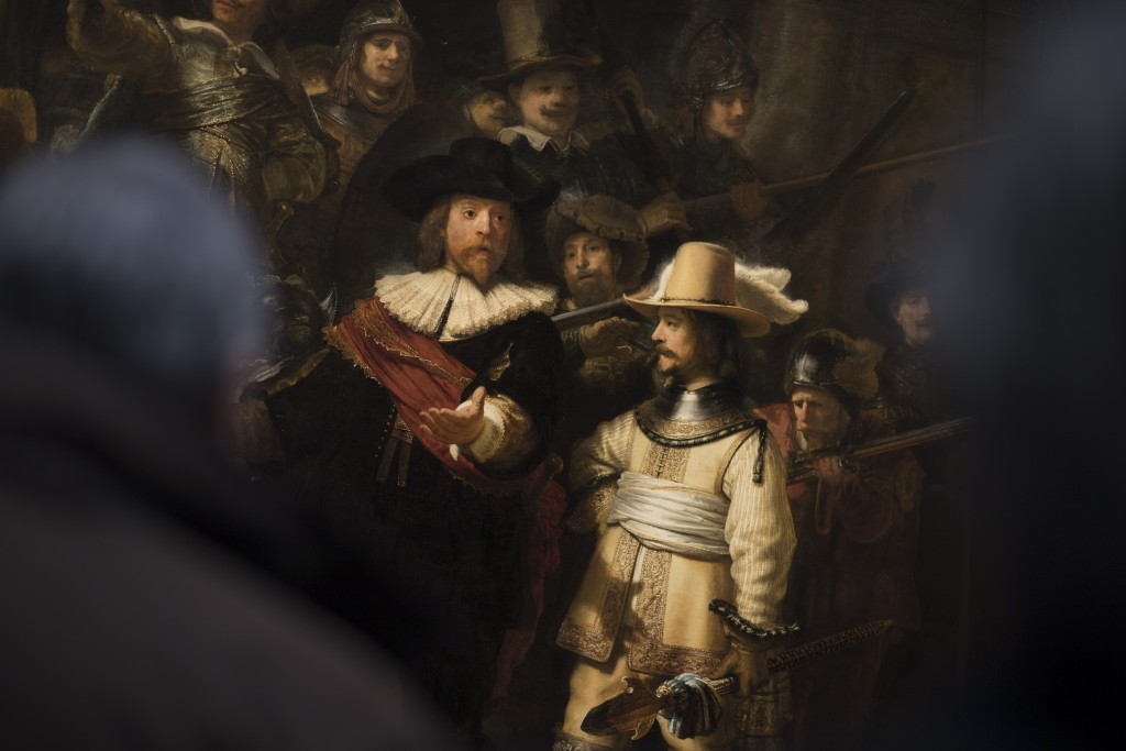 Visitord admire Rembrandt's Night Watch (1642), part of an exhibition of the all the Rijksmuseum's Rembrandts in Amsterdam, Netherlands, Wednesday, Fe