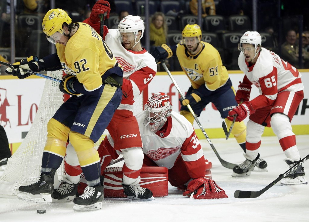 Nashville Predators center Ryan Johansen (92) and Detroit Red Wings defenseman Nick Jensen (3) compete for the puck during the second period of an NHL