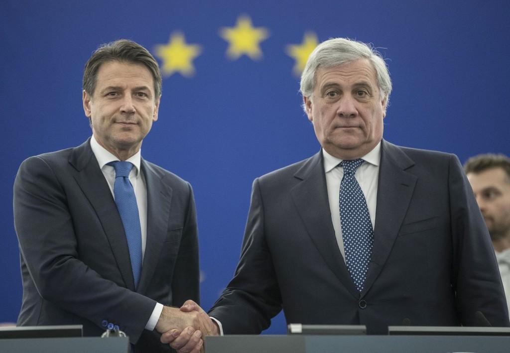 Italian Prime Minister Giuseppe Conte, left, shakes hands with European Parliament President Antonio Tajani prior to a debate on the future Europe at ...