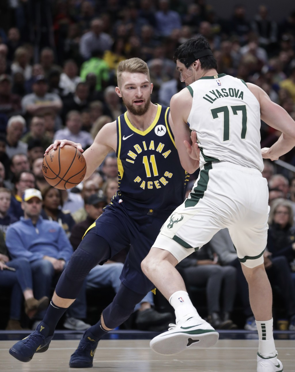 Indiana Pacers forward Domantas Sabonis (11) drives on Milwaukee Bucks forward Ersan Ilyasova (77) during the first half of an NBA basketball game in