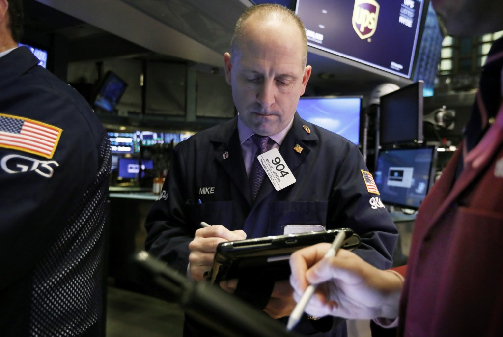 FILE- In this Feb. 5, 2019, file photo trader Michael Urkonis works on the floor of the New York Stock Exchange. The U.S. stock market opens at 9:30 a...