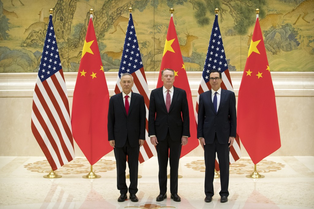 From left, Chinese Vice Premier and lead trade negotiator Liu He, U.S. Trade Representative Robert Lighthizer, and U.S. Treasury Secretary Steven Mnuc...