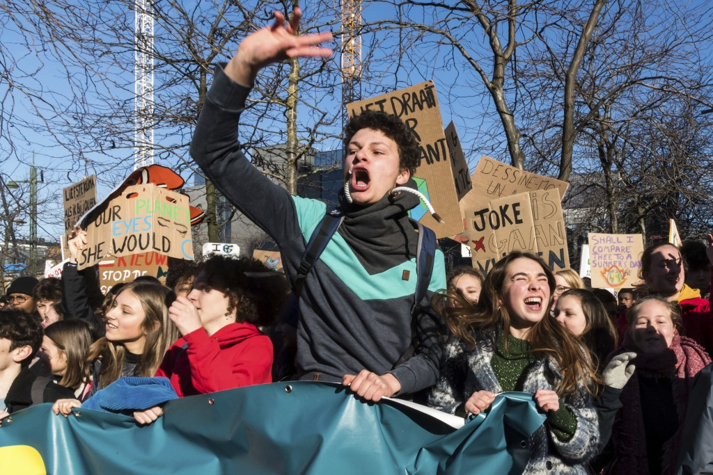 Students march during a climate change protest in Brussels, Thursday, Feb. 14, 2019. Thousands of teenagers in Belgium have skipped school for the sit