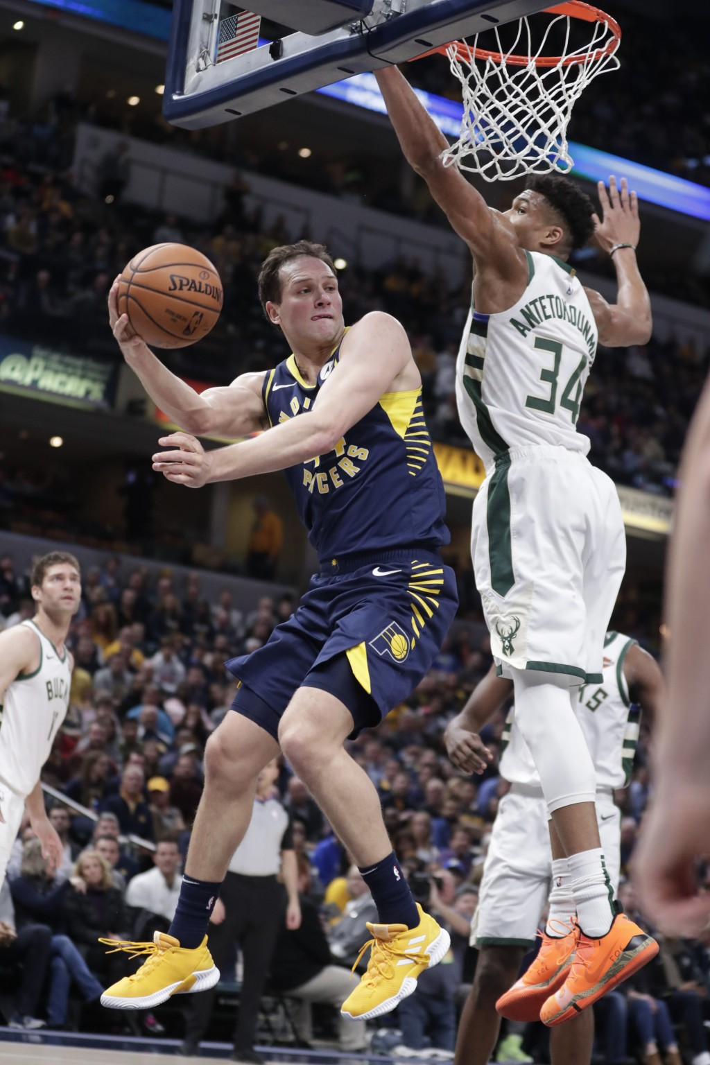 Indiana Pacers forward Bojan Bogdanovic (44) makes a pass around Milwaukee Bucks forward Giannis Antetokounmpo (34) during the first half of an NBA ba