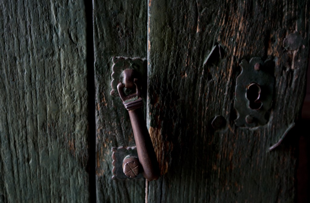 In this Feb. 9, 2019 photo, shows one of knobs and locks of a door at the local church in Curahuara de Carangas, Bolivia. This four-century old church