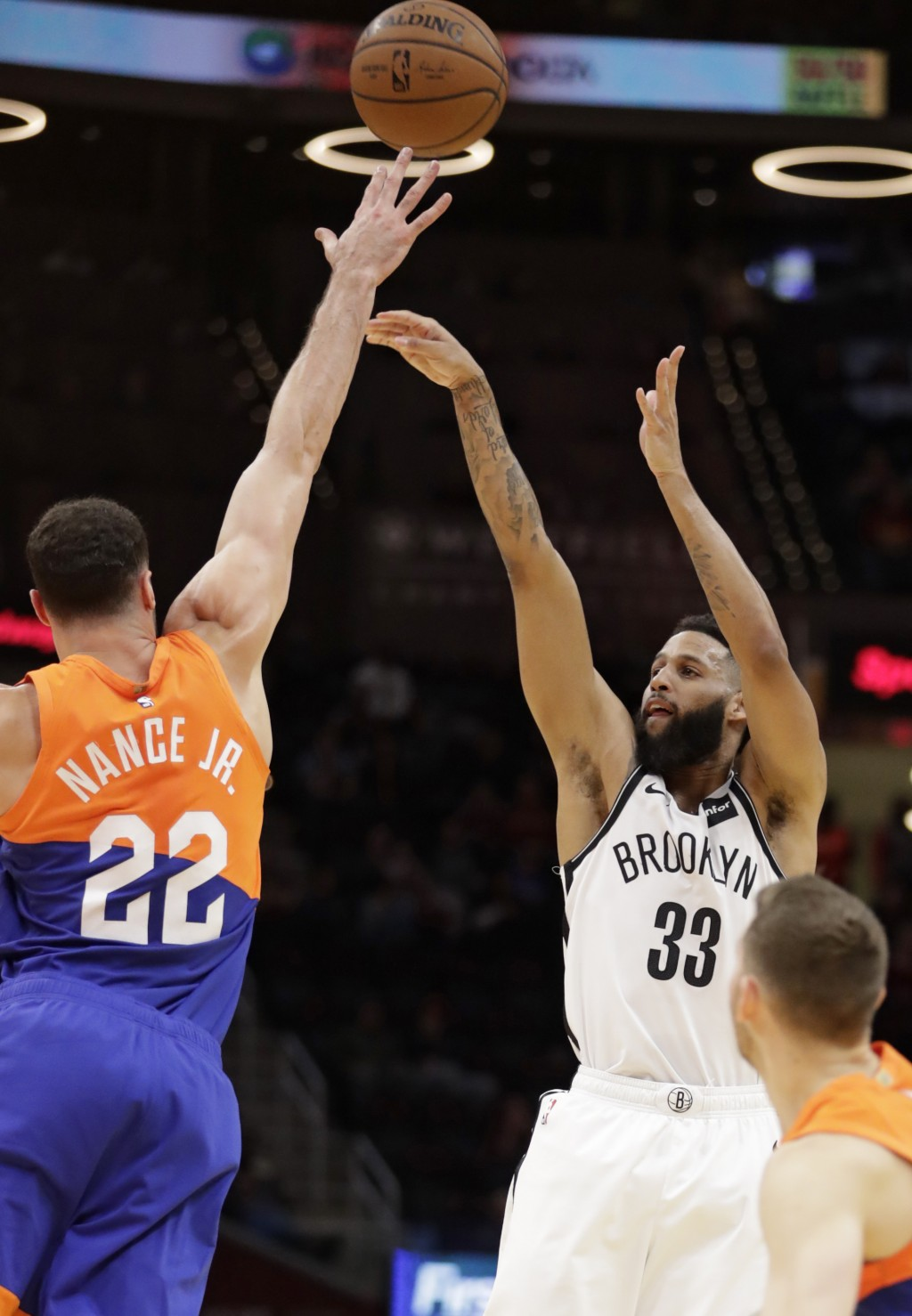 Brooklyn Nets' Allen Crabbe (33) shoots over Cleveland Cavaliers' Larry Nance Jr. (22) in the first half of an NBA basketball game, Wednesday, Feb. 13