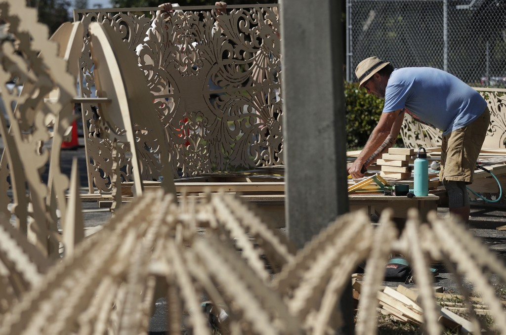 A volunteer helps build a California artist, David Best's vision for a non-denominational, temporary temple for the anniversary of the Marjory Stonema...