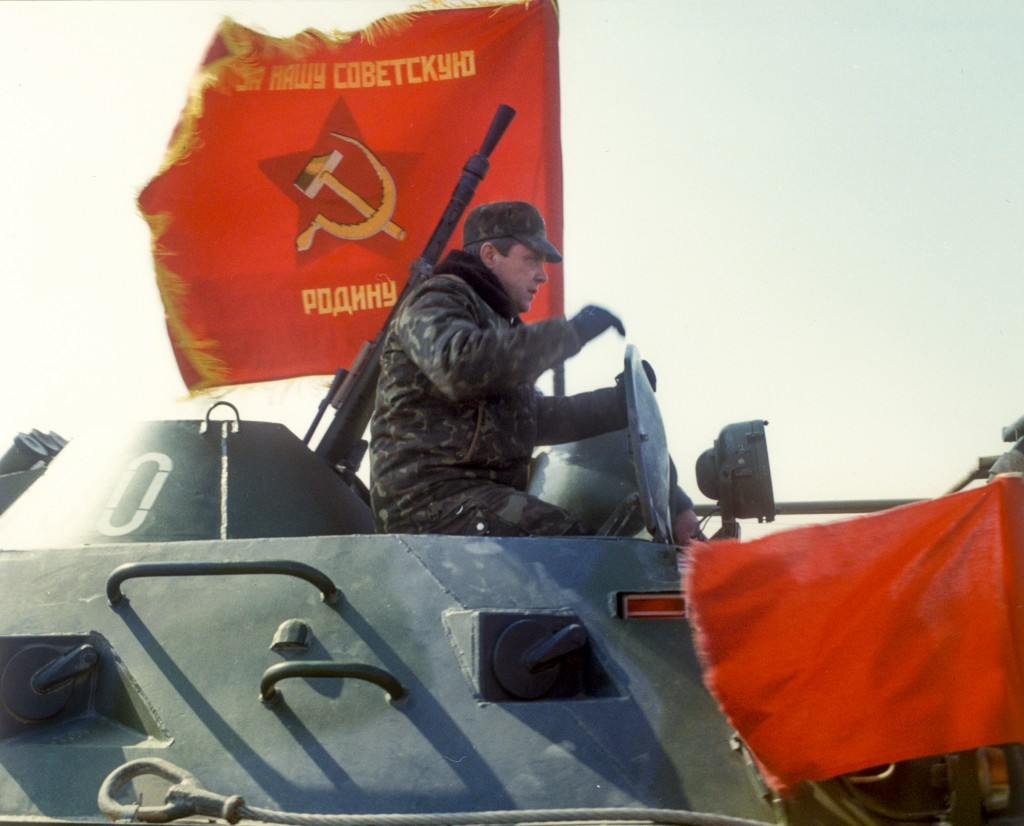 In this photo taken on Feb. 15, 1989, Lt. Gen. Boris Gromov, sits atop of an armored personnel carrier driving from Afghanistan across a bridge over t