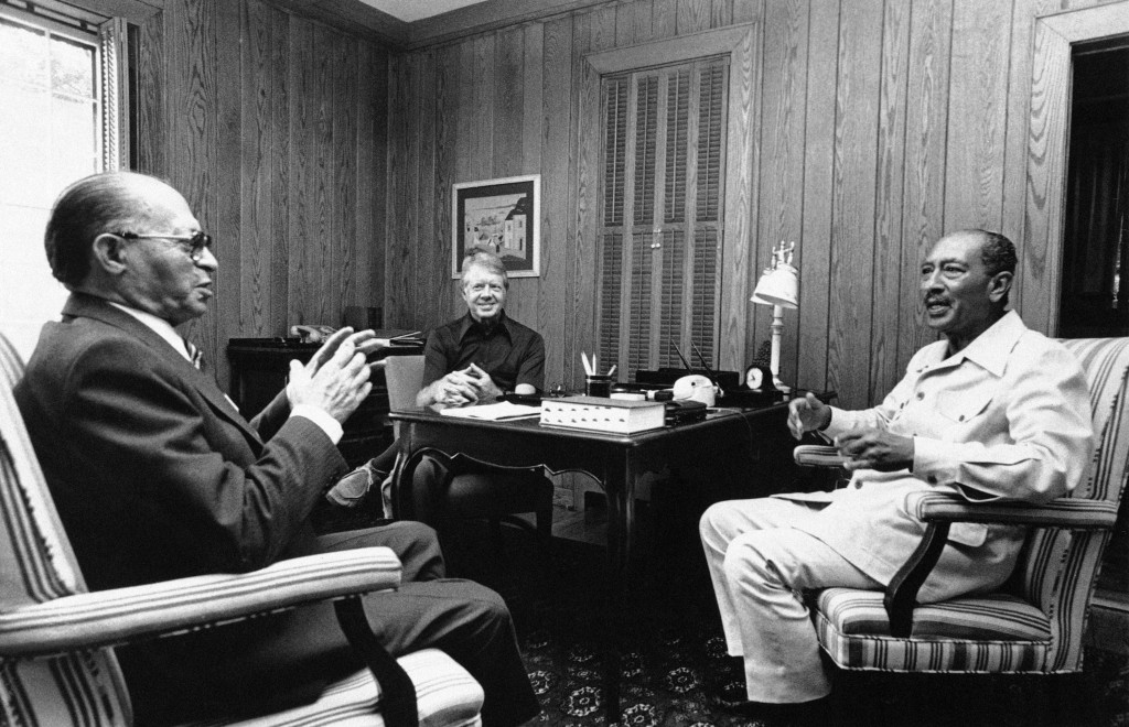 FILE - In this Sept. 7, 1918 photo provided by the White House,  Israeli Prime Minister Menachem Begin, left, President Jimmy Carter, center, and Egyp