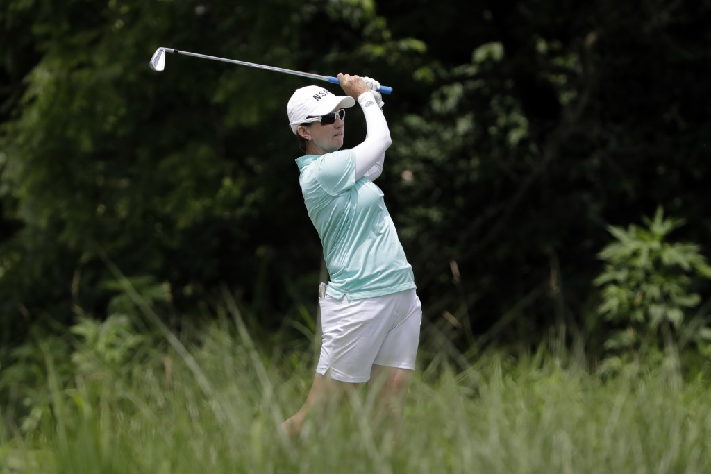 FILE - In this June 27, 2018, file photo, Karrie Webb, of Australia, watches her tee shot on the 17th hole during a practice round for the KPMG Women'...