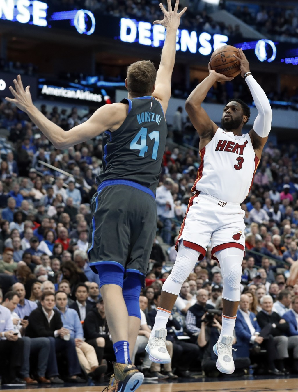 Dallas Mavericks forward Dirk Nowitzki (41) defends as Miami Heat guard Dwyane Wade (3) shoots during the first half of an NBA basketball game in Dall