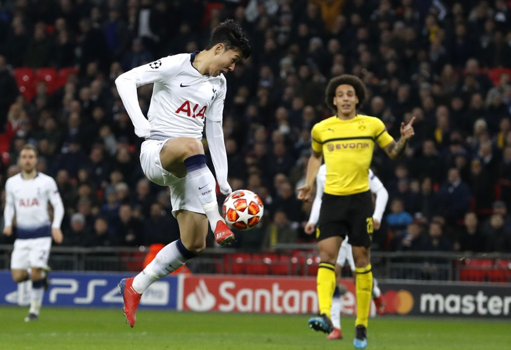 Tottenham midfielder Son Heung-min scores the opening goal during the Champions League round of 16, first leg, soccer match between Tottenham Hotspur
