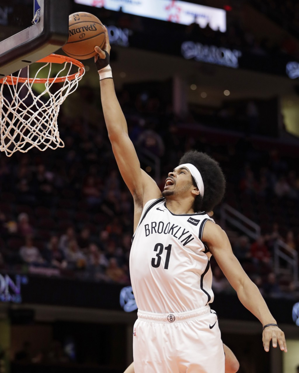 Brooklyn Nets' Jarrett Allen dunks against the Cleveland Cavaliers in the first half of an NBA basketball game, Wednesday, Feb. 13, 2019, in Cleveland