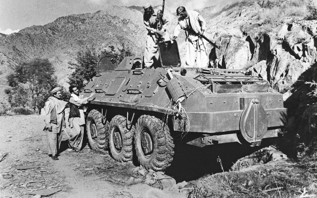 FILE - In this Dec. 27, 1979, file photo, rebel Muslim fighters inspect a Soviet tank captured in fighting with the Kabul government forces on near As