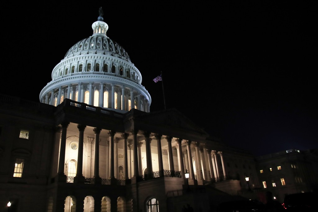 FILE- In this Feb. 5, 2019, file photo lights illuminate the U.S. Capitol dome in Washington. On Thursday, Feb. 14, the Labor Department reports on th...