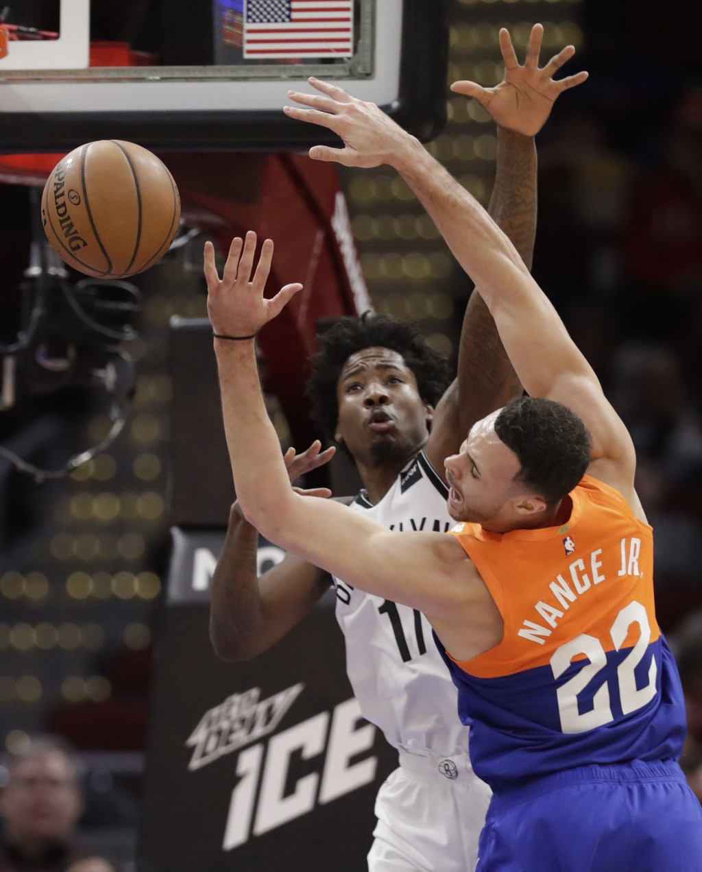 Cleveland Cavaliers' Larry Nance Jr. (22) is stopped by Brooklyn Nets' Ed Davis (17) in the first half of an NBA basketball game, Wednesday, Feb. 13,