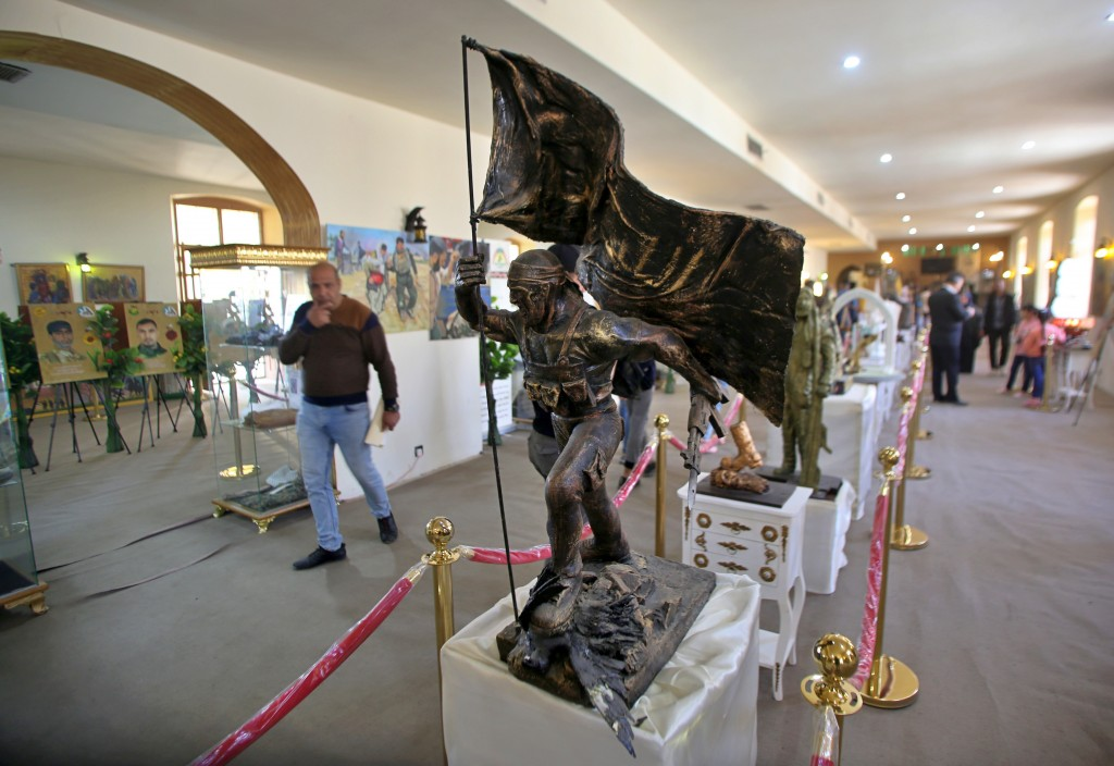 In this Friday, Feb. 1, 2019 photo, statues and other commemorative works depicting the fight with the Islamic State group, are on display in the Popu