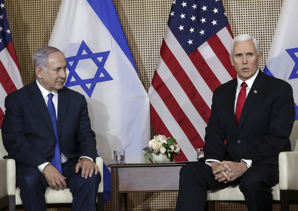 United States Vice President Mike Pence, right, talks to the media during a bilateral meeting with Israeli Prime Minister Benjamin Netanyahu, left, in...