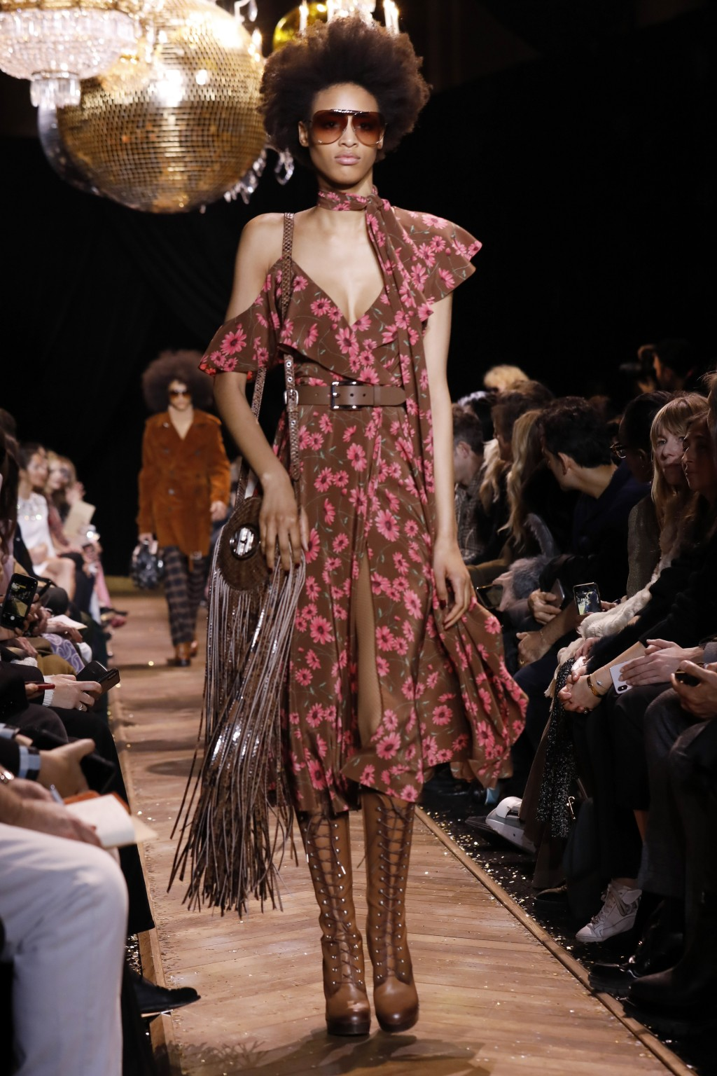 The Michael Kors collection is modeled during Fashion Week in New York, Wednesday, Feb. 13, 2019. (AP Photo/Richard Drew)