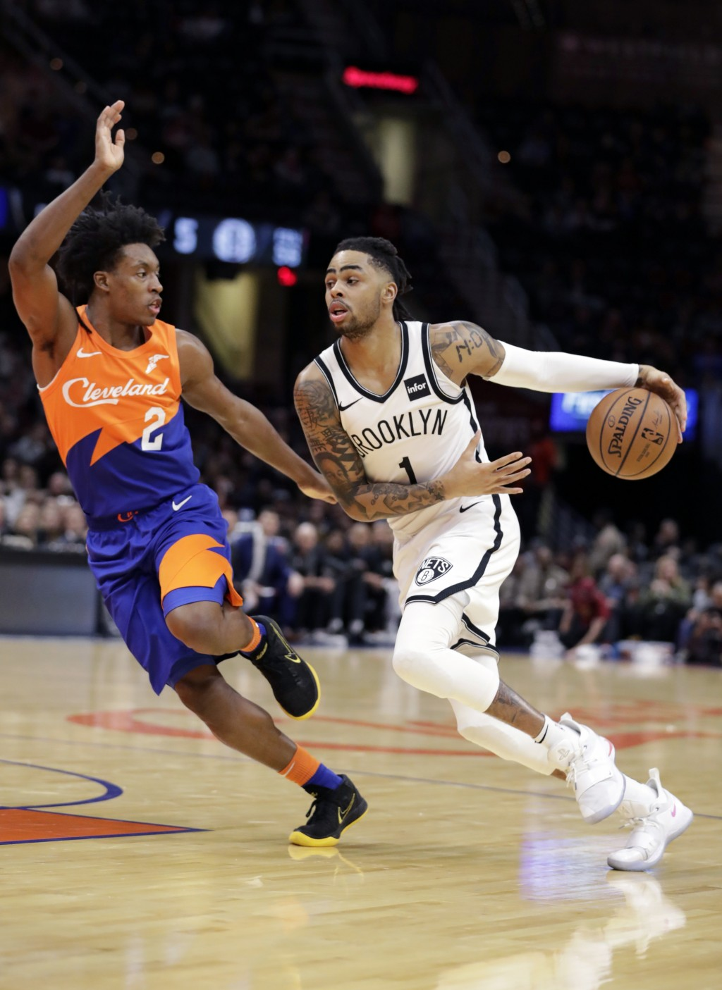 Brooklyn Nets' D'Angelo Russell (1) drives against Cleveland Cavaliers' Collin Sexton (2) in the first half of an NBA basketball game, Wednesday, Feb.