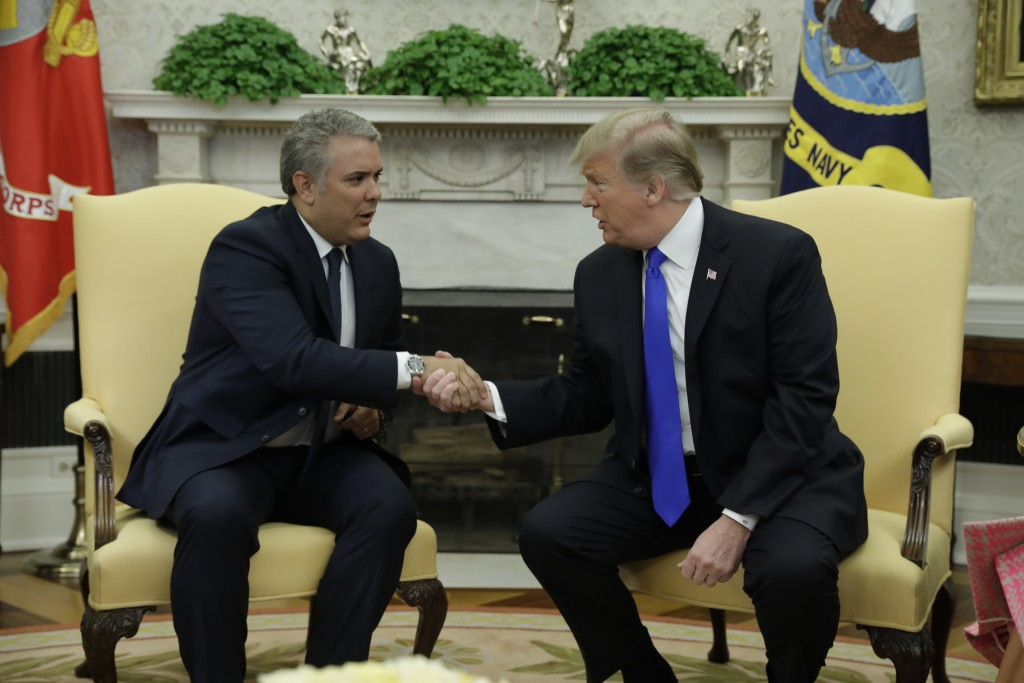 President Donald Trump meets with Colombian President Ivan Duque Marquez in the Oval Office of the White House, Wednesday, Feb. 13, 2019, in Washingto...