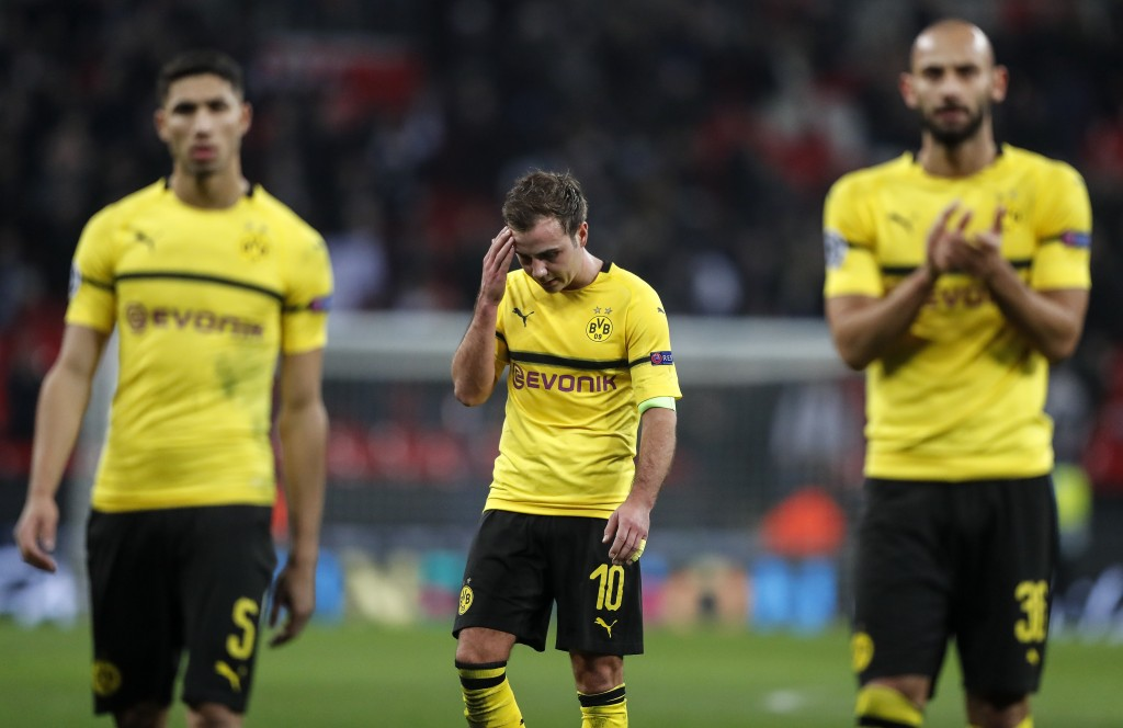 Dortmund midfielder Mario Gotze, center, reacts after losing the Champions League round of 16, first leg, soccer match between Tottenham Hotspur and B