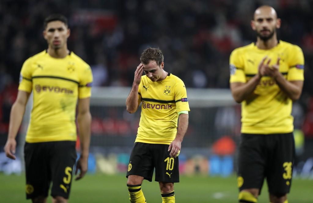 Dortmund midfielder Mario Gotze, center, reacts after losing the Champions League round of 16, first leg, soccer match between Tottenham Hotspur and B...