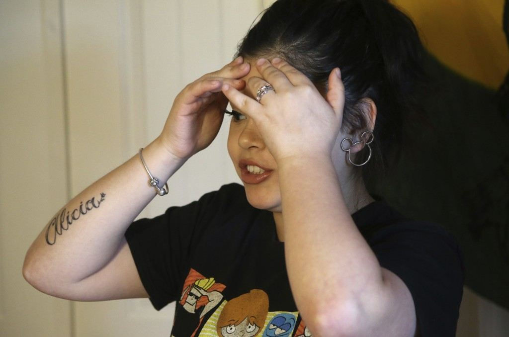 Seanna Leilani Chavez, the sister of Aaron Francisco Chavez, speaks with frustration as she stands next to a shrine for Aaron at the family home Wedne...