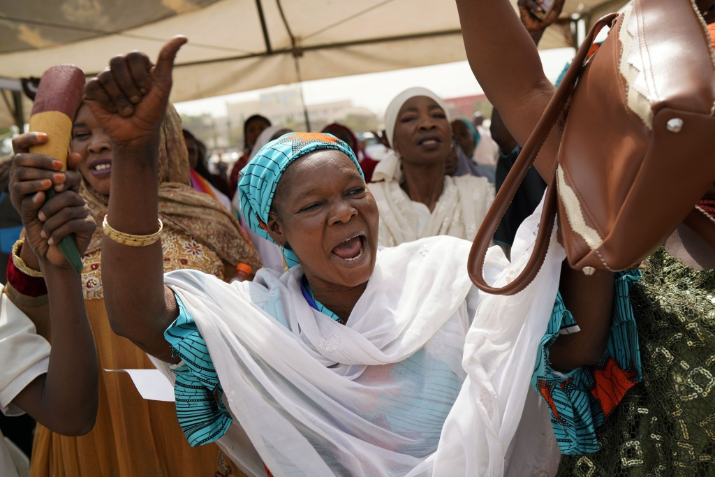 Nigerian women attend an inter-faith prayer rally organized by the Freedom and Justice Party in Abuja, Nigeria, Thursday Feb. 14, 2019. Incumbent Pres