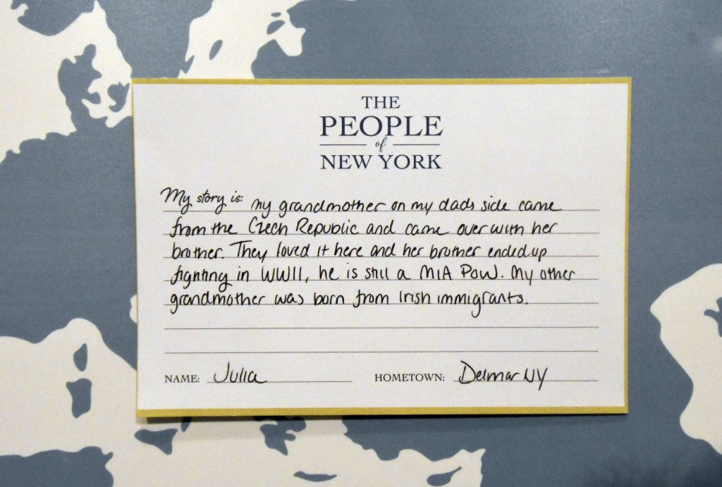 """In this Monday, Feb. 11, 2019 photo, a hand written card which is now part of the """"People of New York""""  diversity exhibit is on display at the state C..."""