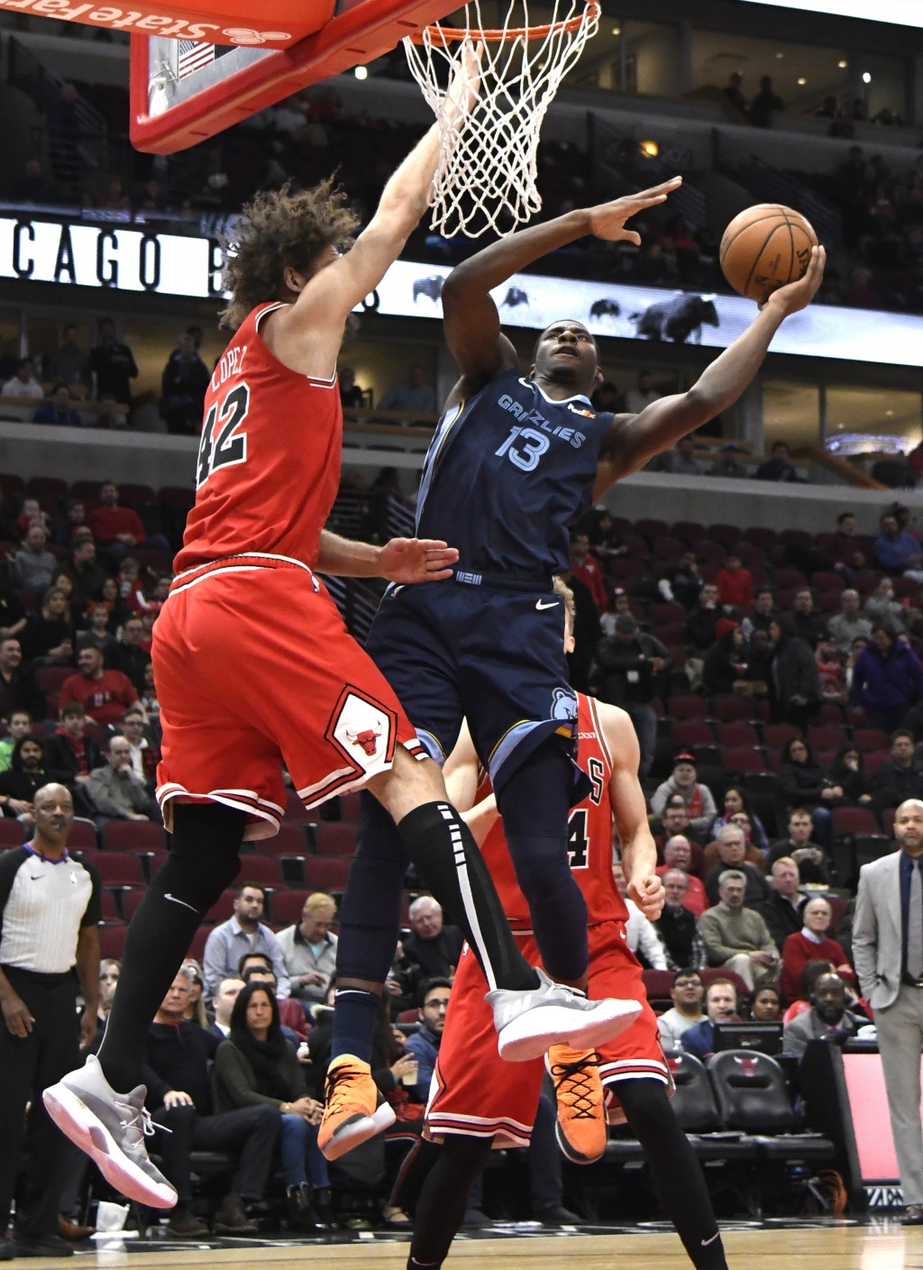 Memphis Grizzlies forward Jaren Jackson Jr. (13) goes to the basket as Chicago Bulls center Robin Lopez (42) defends during the first half of an NBA b...