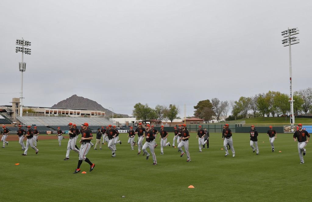 The San Francisco Giants workout during a baseball spring training practice, Wednesday, Feb. 13, 2019, in Scottsdale, Ariz. (AP Photo/Matt York)