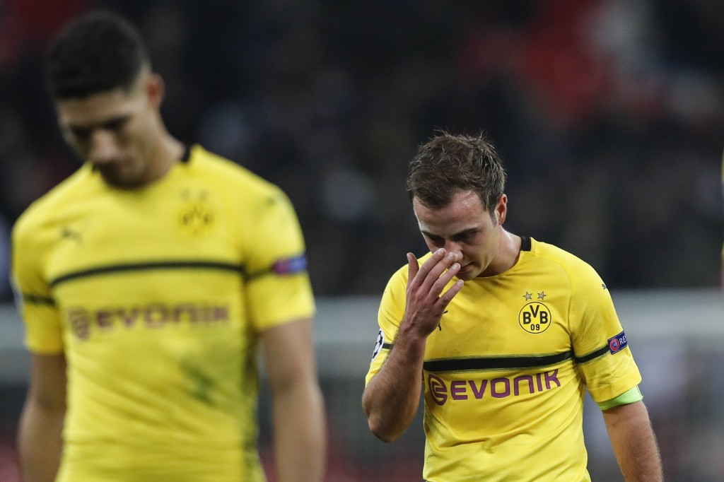 Dortmund midfielder Mario Gotze, right, reacts after losing the Champions League round of 16, first leg, soccer match between Tottenham Hotspur and Bo...