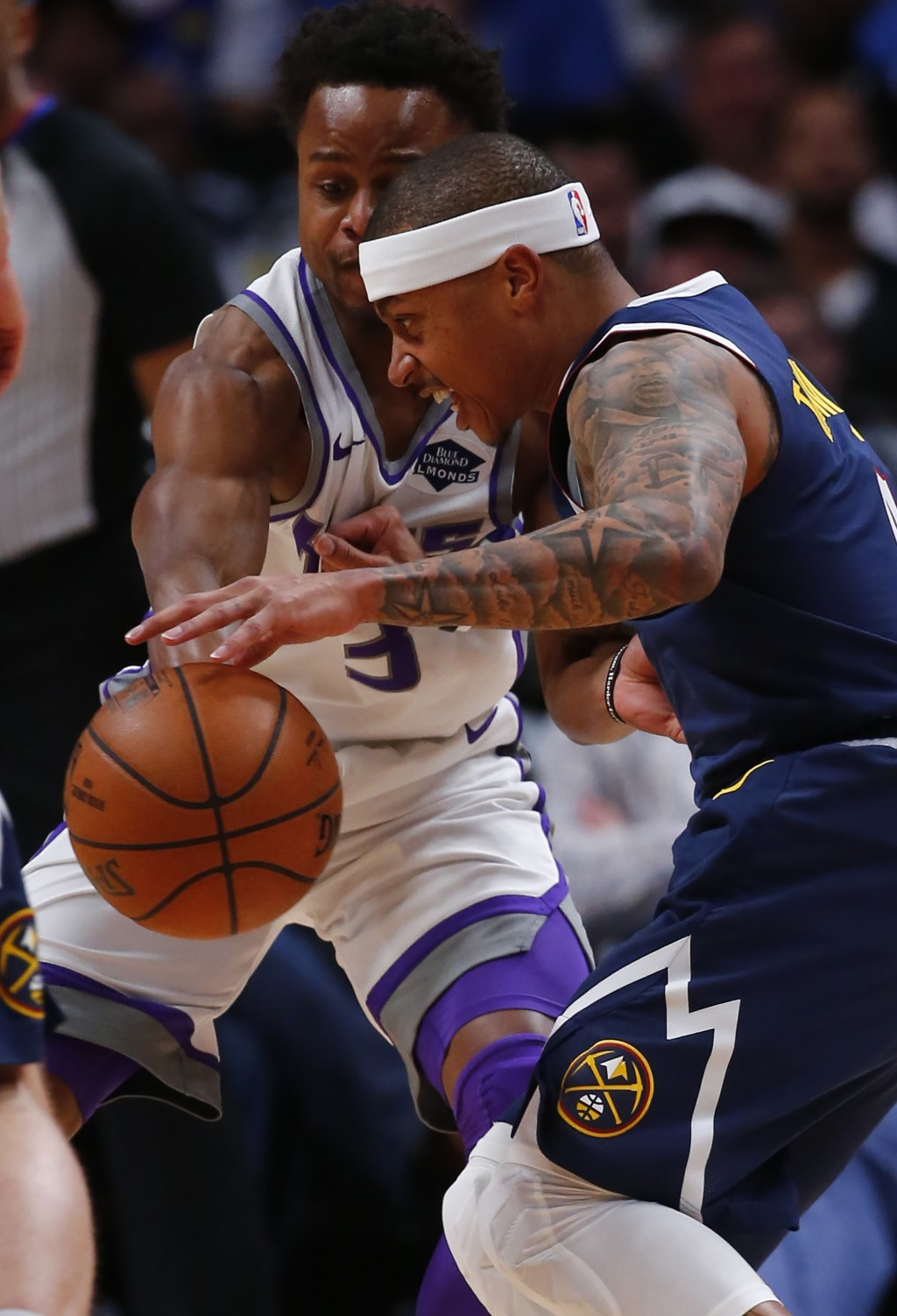 Denver Nuggets guard Isaiah Thomas (0) moves around Sacramento Kings guard Yogi Ferrell (3) during the first half of an NBA basketball game Thursday, ...
