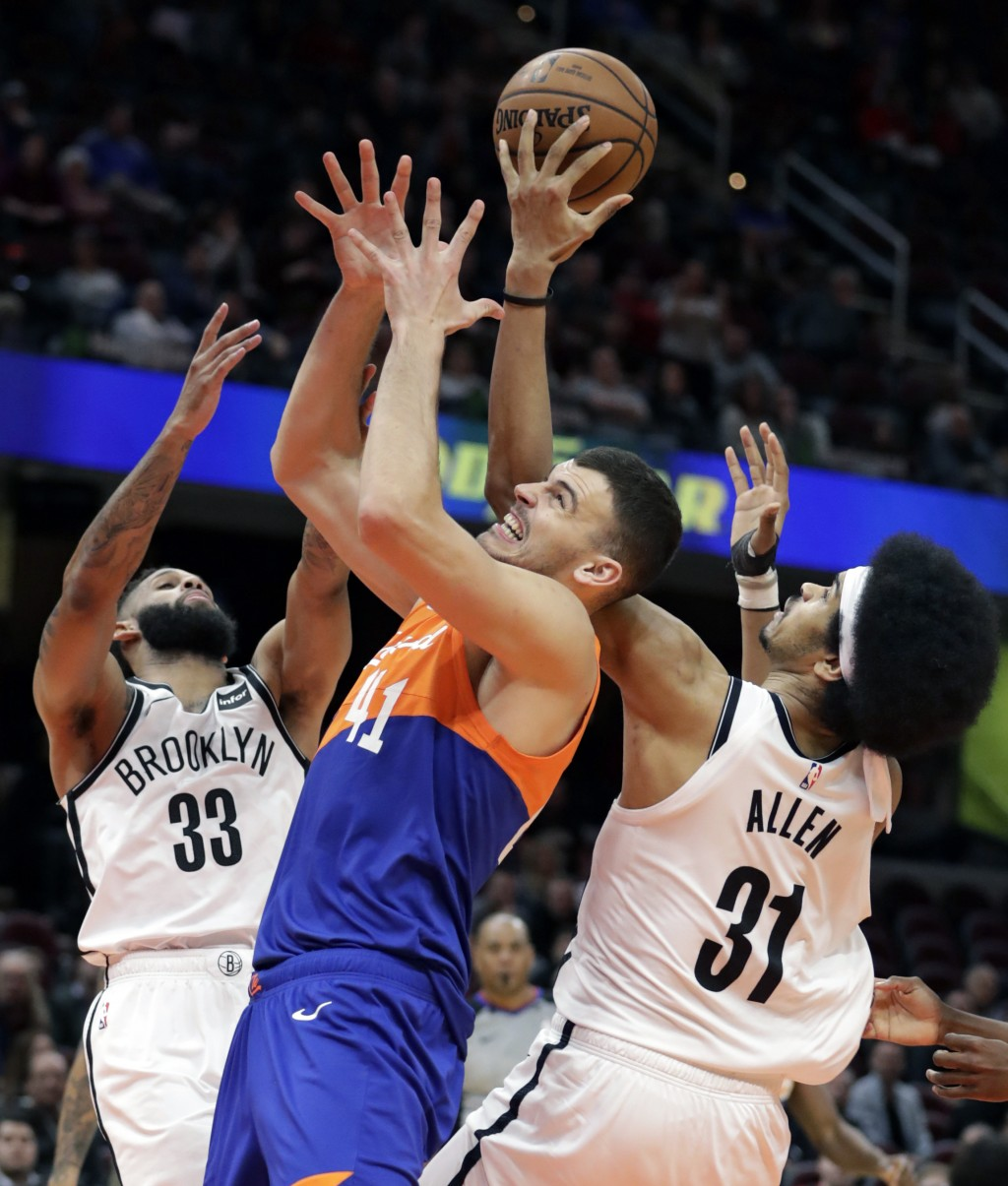 Brooklyn Nets' Allen Crabbe (33), Jarrett Allen (31) and Cleveland Cavaliers' Ante Zizic (41), from Croatia, battle for a loose ball in overtime of an