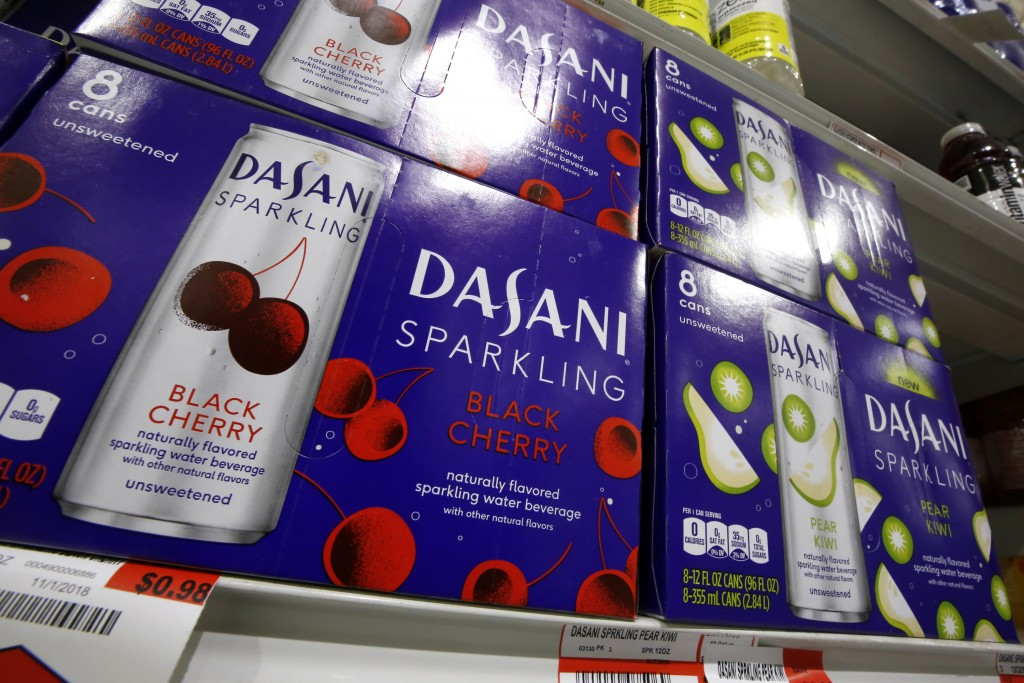FILE- This Nov. 14, 2018, file photo shows Dasani sparkling water, a Coca-Cola product, on display at a market in Pittsburgh. The Coca-Cola Co. report